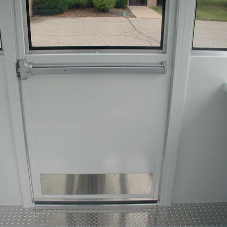GUARDHOUSE BULLET RESISTING DOOR SHOWING PANIC BAR, HEAVY DUTY CLOSER, AND STANDARD STAINLESS KICK PANEL