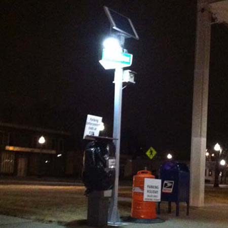 PAY ON FOOT LIGHTED SIGN LETS PATRONS KNOW WHERE TO GO