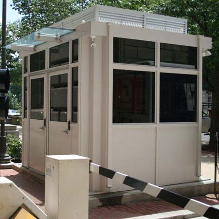 GUARD HOUSE bullet resisting UL level IV. Special features include ribbed exterior, split windows, glass overhangs, and louvered air conditioner wall on roof.