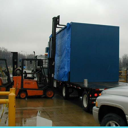 Prefabricated Control Booth being unloaded from truck by customer