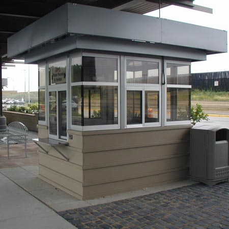 Cashier booth walk up with cashier window and exterior stainless steel shelf